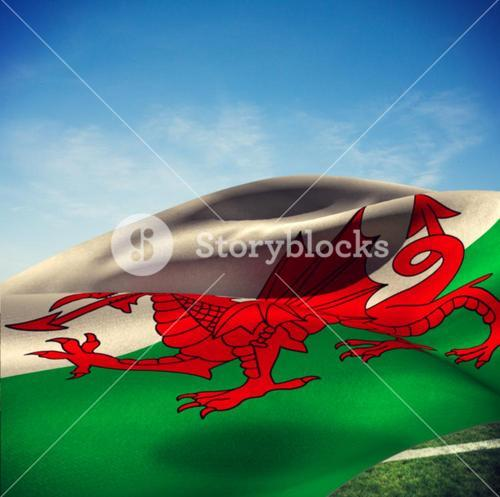 Composite image of waving flag of wales