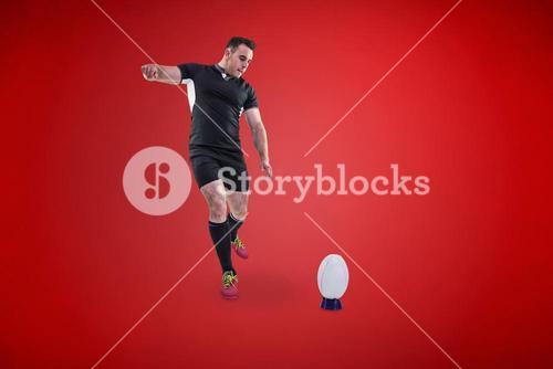 Composite image of rugby player kicking the ball