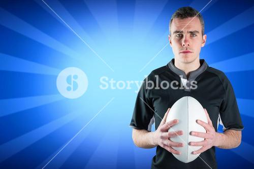 Composite image of a frowning standing rugby player