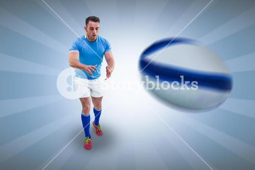 Composite image of rugby player ready to catch