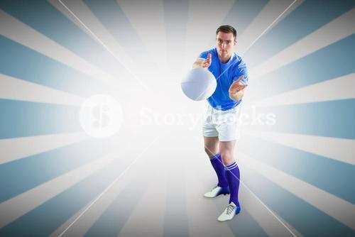 Composite image of rugby player catching a rugby ball