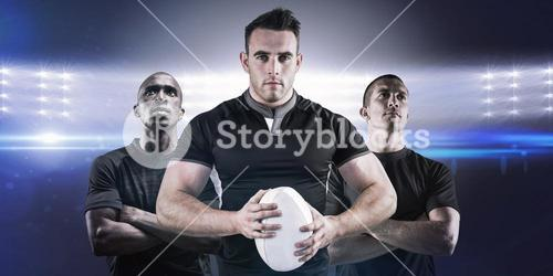 Composite image of tough rugby player looking at camera