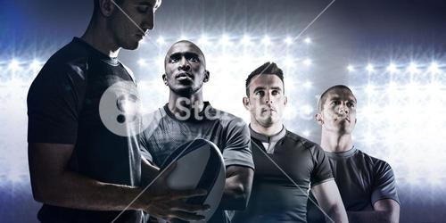 Composite image of calm rugby player thinking while holding ball