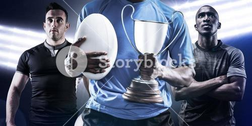 Composite image of mid section of sportsman holding trophy and rugby ball