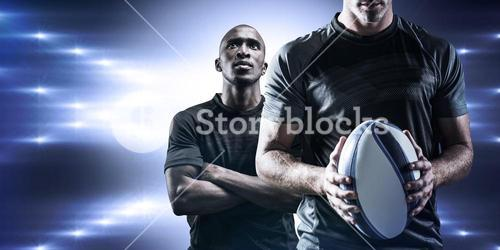 Composite image of thoughtful rugby player holding ball