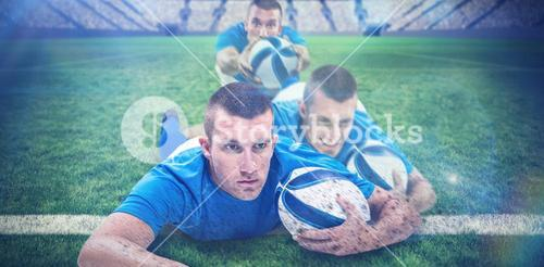 Composite image of rugby player looking away while lying in front with ball