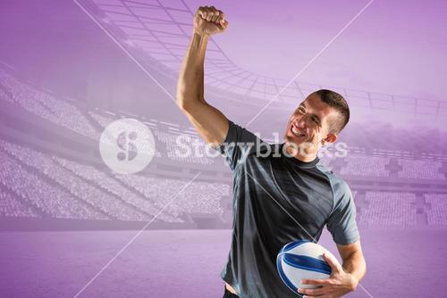 Composite image of cheerful rugby player punching the air