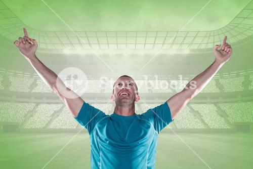 Composite image of happy rugby player with arms raised
