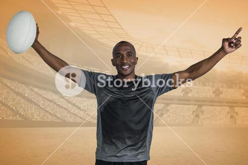 Composite image of confident sportsman with arms raised holding rugby ball