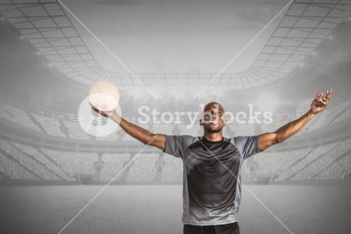 Composite image of confident athlete with arms raised holding rugby ball