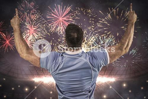 Composite image of rugby player cheering and pointing