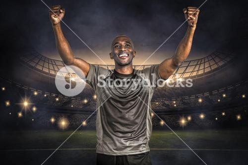 Composite image of happy sportsman with clenched fist after victory