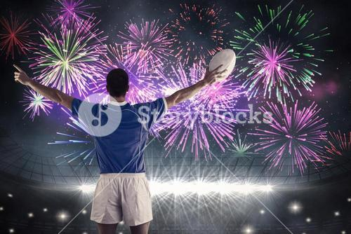 Composite image of rugby player about to throw a rugby ball