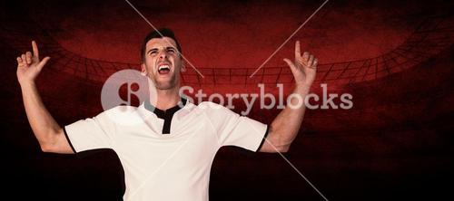 Composite image of excited rugby player pointing up