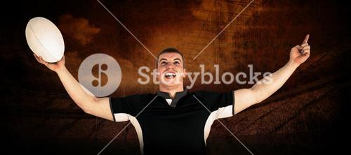 Composite image of a rugby player gesturing victory