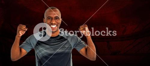 Composite image of portrait of rugby player cheering after success in game