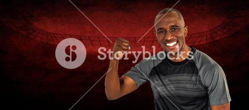 Composite image of portrait of sportsman cheering after success in rugby