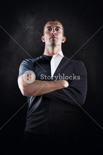 Composite image of confident rugby player with arms crossed