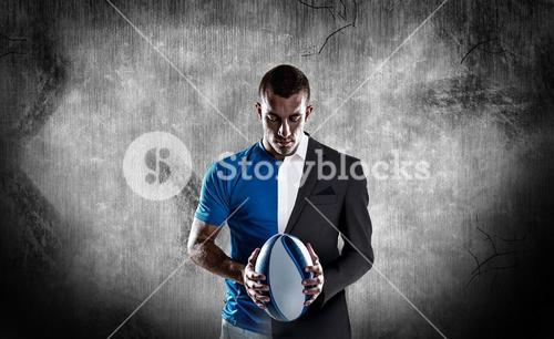 Composite image of rugby player holding ball