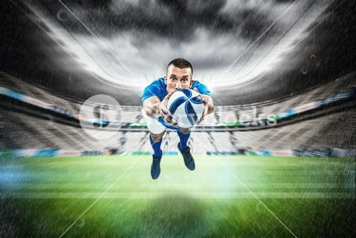 Composite image of portrait full length of american football player diving