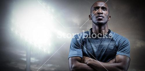 Composite image of thoughtful athlete standing with arms crossed