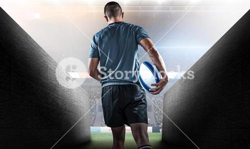 Composite image of rear view of rugby player running with ball