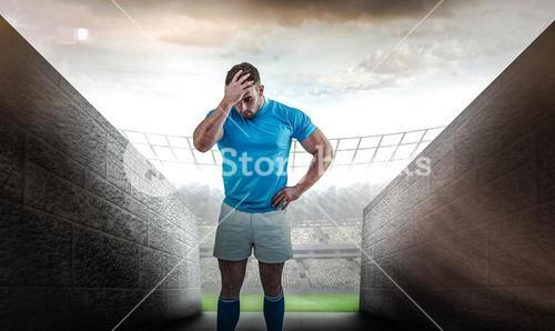 Composite image of rugby player after a loss