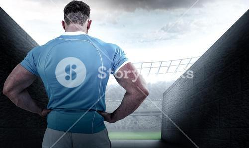 Composite image of rugby player with hands on hips