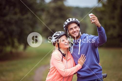 Happy couple on a bike ride