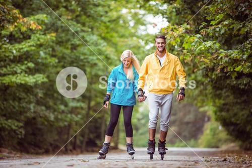 Happy couple roller blading together