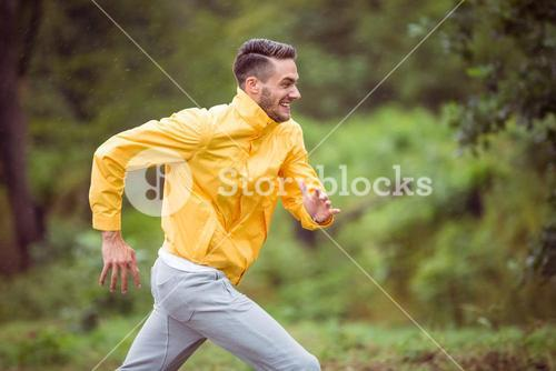 Happy man running on a hike