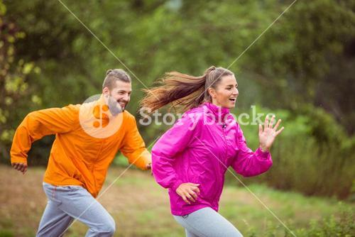Happy couple running on a hike