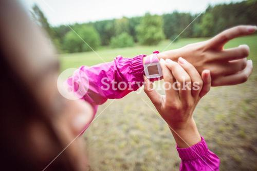 Woman using her smartwatch on a hike