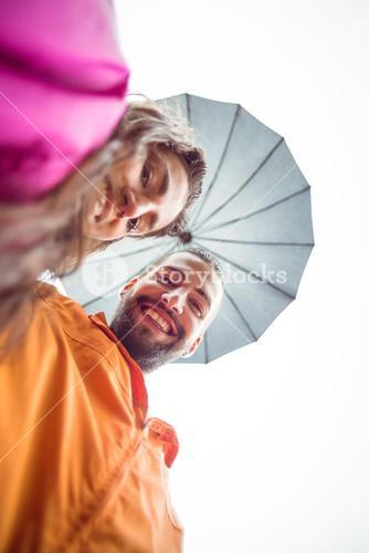 Happy couple under an umbrella