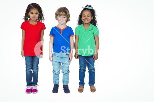 Three small kids standing in a line
