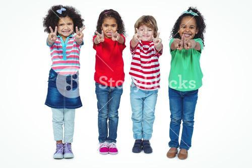 Smiling kids holding up fingers making peace signs