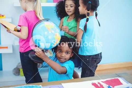 Small group of kids in playing with toys