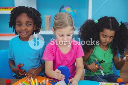 Happy kids doing arts and crafts together