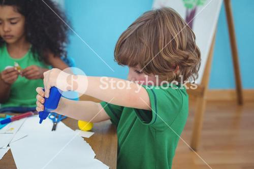 Small boy using arts and crafts supplies