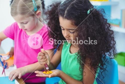 Girls making arts and crafts together