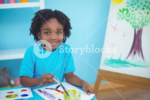 Happy kid enjoying arts and crafts painting