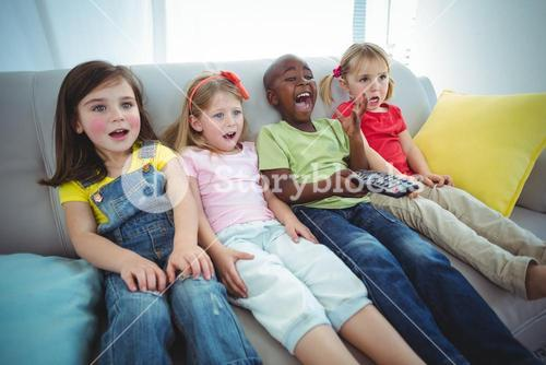 Happy kids laughing while sitting down