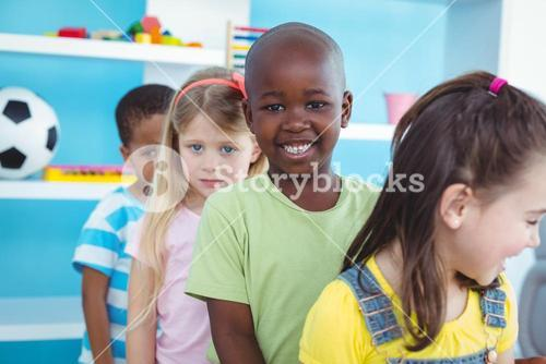 Happy kids standing in a line