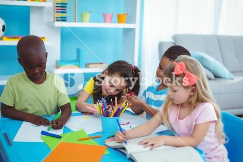 Happy kids enjoying arts and crafts together