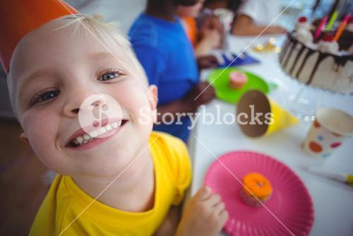 Excited kid enjoying a birthday party