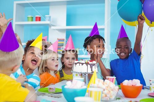 Excited kids enjoying a birthday party