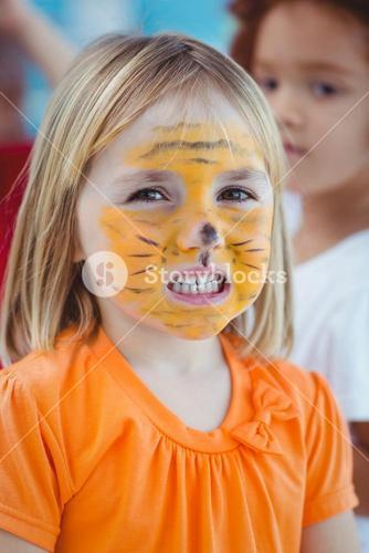 Happy girl with her face painted