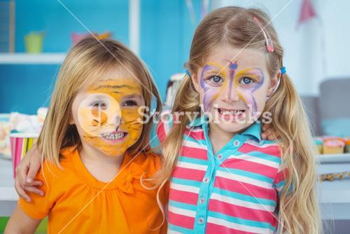 Smiling girls with their faces painted