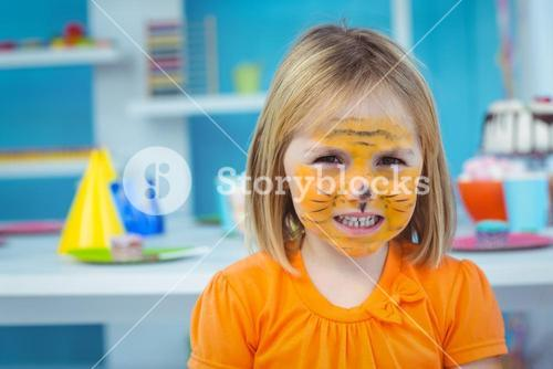 Smiling girl with her face painted