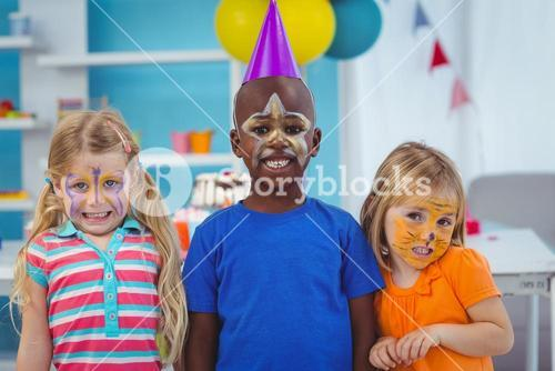 Smiling kids with faces painted
